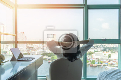 Image Work-life balance relaxation with Asian working business woman healthy lifestyle take it easy resting in comfort city hotel or home living room having good time with peace of mind, self-satisfaction