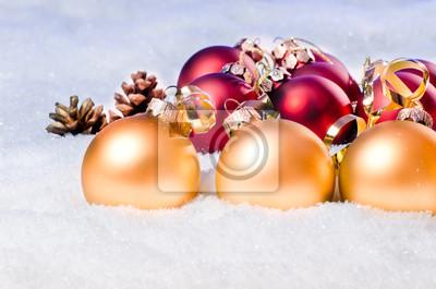 x-mas balls in the snow