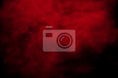 Image Fumée rouge abstraite sur fond noir. Nuages de couleur rouge.