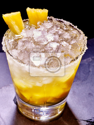 Yellow cube ice of cold drink  with  pineapple on dark