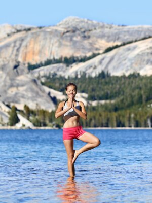 Yoga meditation woman meditating in nature lake