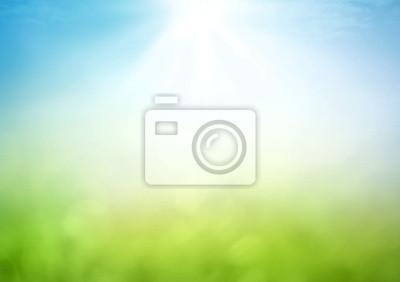 Papiers peints Abstrait floue belle prairie lumineuse bokeh vert et ciel bleu sur le lever du soleil de l'automne.