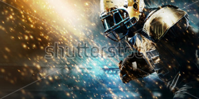 Papiers peints American football sportsman player on stadium running in action. Sport wallpaper with copyspace.