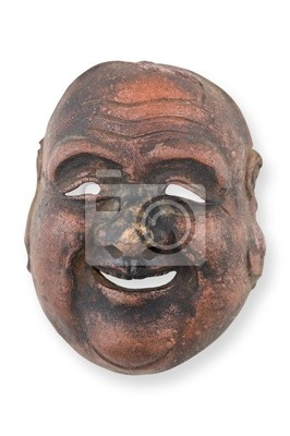 Ancien masque en bois isolé sur blanc.