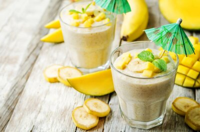 banana mango smoothie on a wood background