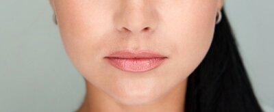 Papiers peints Beautiful lips Close-up. Makeup. Lip matte lipstick. Sexy lips. Part of face, young woman close up