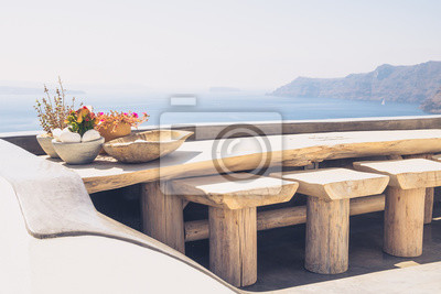 Beautiful vintage wooden table and chairs on terrace for Papier peint a effet d optique