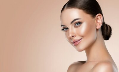 Papiers peints Beautiful young woman with clean fresh skin on face . Girl facial  treatment   . Cosmetology , beauty  and spa .