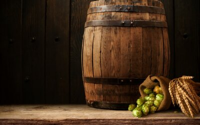 Beer Mug With Wheat And Hops In Cellar With Barrel