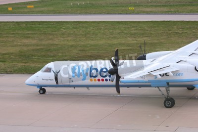 Papiers peints BIRMINGHAM, UK - APRIL 24, 2013: Pilots taxi Flybe Bombardier Dash 8 Q-400 at Birmingham Airport, UK. Flybe carried 7.6 million passengers in 2013.