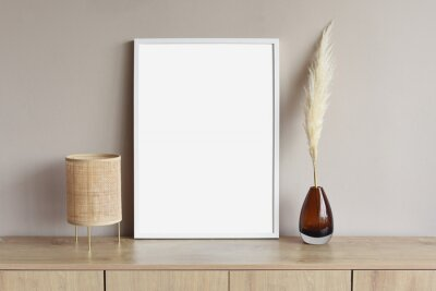 Papiers peints Blank picture frame mockup on gray wall. White living room design. View of modern scandinavian style interior with artwork mock up on wall. Home staging and minimalism concept