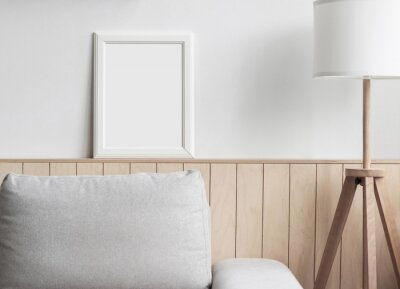 Papiers peints Blank picture frame mockup on white wall. White living room design. View of modern scandinavian style interior with chair. Home staging and minimalism concept