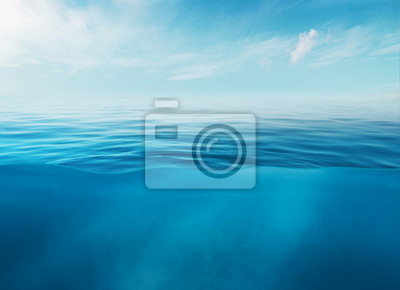 Papiers peints Blue sea or ocean water surface and underwater with sunny and cloudy sky