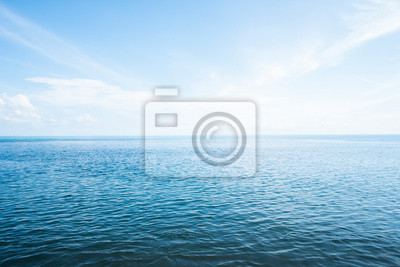 Papiers peints Blue sea with waves and sky with clouds.