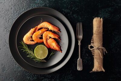 Boiled shrimps with rosemary and lime.