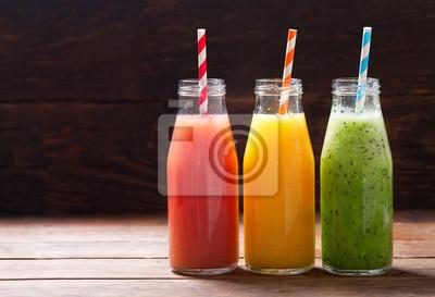 bottles of fresh fruit juice and smoothie