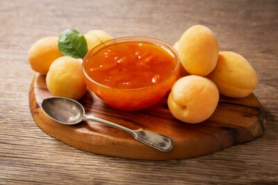bowl of apricot jam with fresh fruits