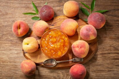 bowl of peach jam and fresh fruits, top view