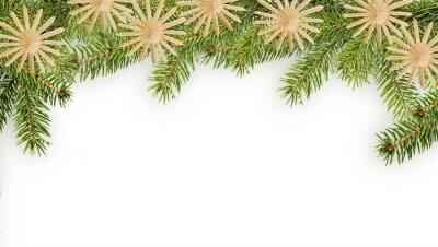 branches de sapin avec des étoiles de paille