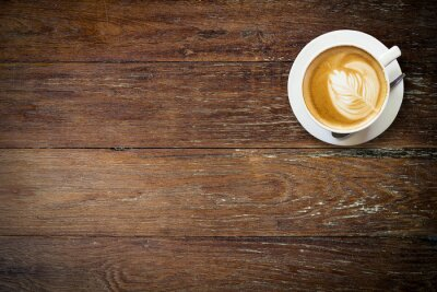 Papiers peints café latte sur bois avec l'espace.