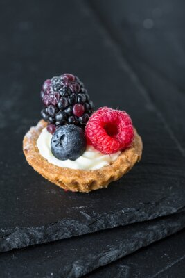 Cakes with fresh berries. Tartlets with raspberries, blackberries and blueberries