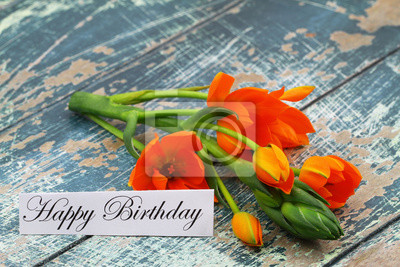 Carte De Joyeux Anniversaire Avec Des Fleurs Orange Sur Une Surface