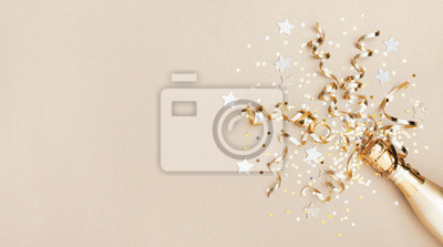 Papiers peints Celebration background with golden champagne bottle, confetti stars and party streamers. Christmas, birthday or wedding concept. Flat lay.