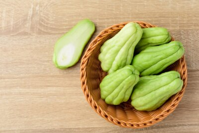 Chayote squash or Mirlition squash in basket, Organic vegetable, Edible plant fruit