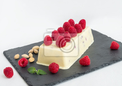 Cheese ice-cream with fresh raspberry and pistachios