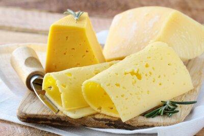 Papiers peints Cheeseboard différents types de fromage pour un apéritif