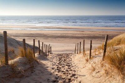 Papiers peints chemin de sable à la mer du Nord au coucher du soleil