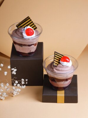 chocolate dessert in a glass on a colorful background