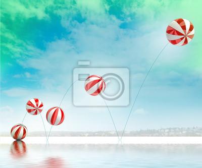 cinq blanche saut ballons gonflables rayée rouge sur la plage