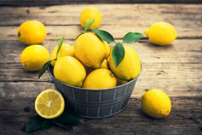 Papiers peints Citrons frais sur le conte rustique