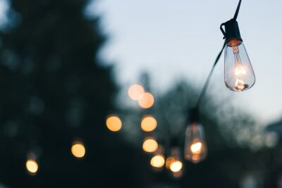 Papiers peints Close-up Of Illuminated Light Bulb Against Sky
