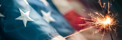Papiers peints Close-up Of Vintage American Flag With Sparkler And Smoke - Fourth Of July Background