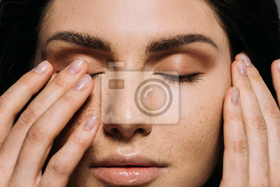 Papiers peints close up view of tender girl with freckles on face touching closed eyes
