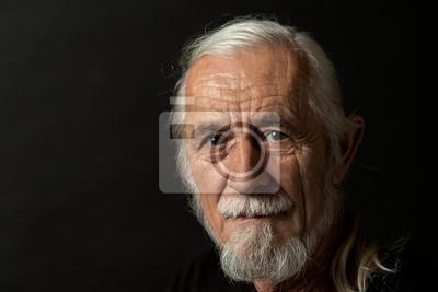 Papiers peints Closeup low key studio portrait of beautiful gray hair old man looking at the camera. Horizontally.