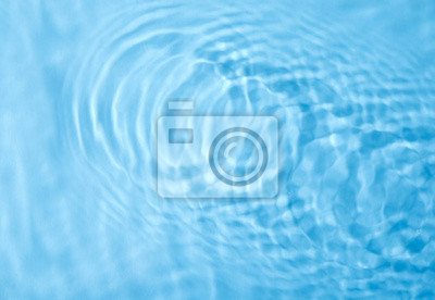 Papiers peints Concentric waves on blue water surface after falling drops, top view