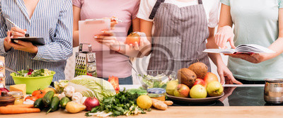 Papiers peints Cooking classes. Food preparing hobby. Group of women learning healthy eating lifestyle and balanced nutrition.