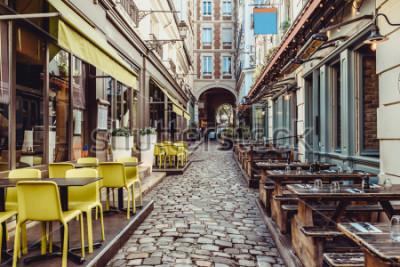 Papiers peints Cozy street near Boulevard San-German with tables of cafe and pub  in Paris, France. Architecture and landmarks of Paris. Postcard of Paris