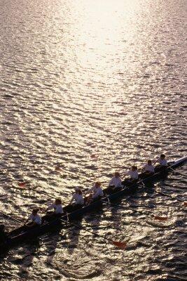 Papiers peints Crew team rowing in water