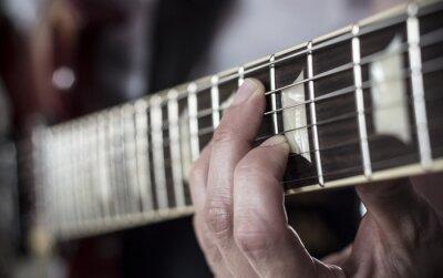 Papiers peints Dedos sur diapasón de guitarra