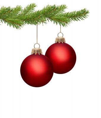 Deux boules de Noël rouge sur une branche de pin