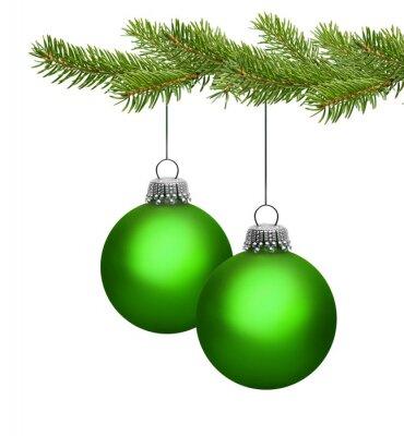 Deux boules de Noël vert sur la branche de pin