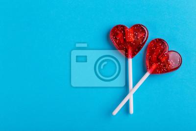 Papiers peints Deux sucettes sucrées rouges en forme de coeur