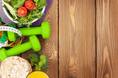 Papiers peints Dumbells, tape measure and healthy food over wooden table