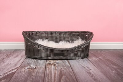 Empty dog bed on a pink background