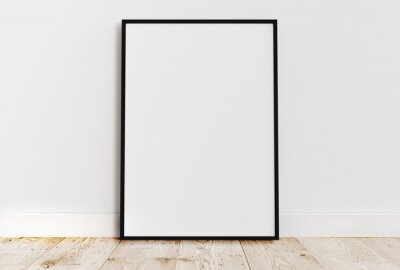 Papiers peints Empty thin black frame on light wooden floor with white wall behind it. Empty poster frame mockup. Empty picture frame mockup. Blank photo frame.