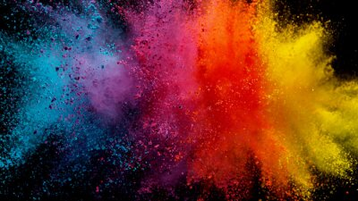 Papiers peints Explosion of colored powder on black background